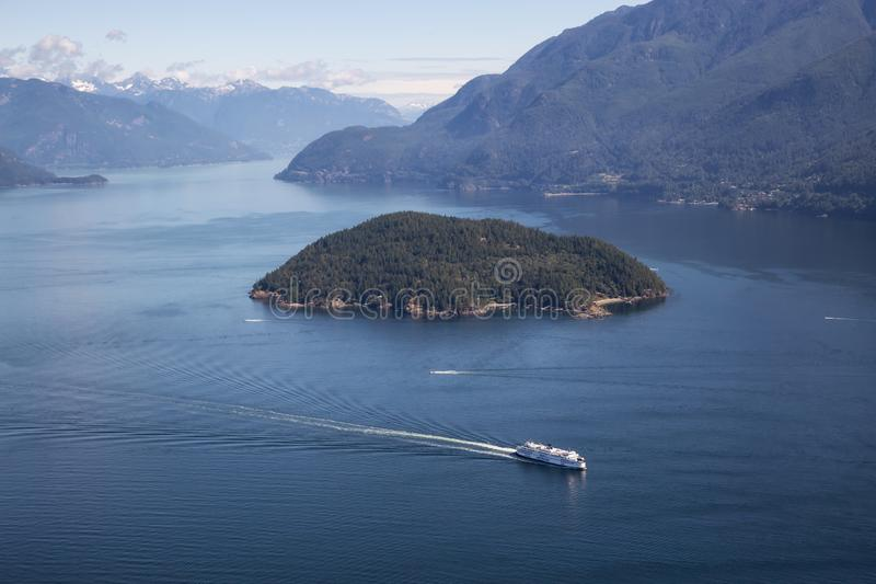 Ferry in Howe Sound Aerial View. Howe Sound, Vancouver, BC, Canada - July 21, 2018: Aerial view of BC Ferry traveling in the ocean during a vibrant sunny summer royalty free stock photography