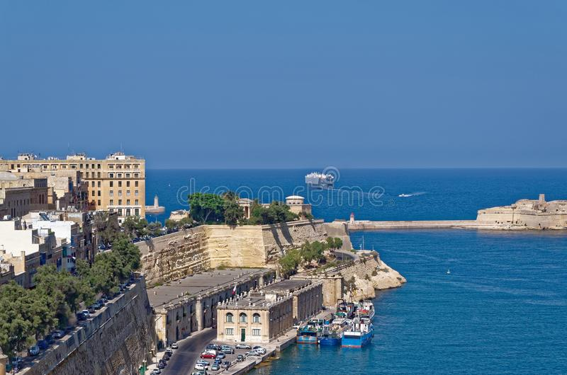 A ferry leaves a harbor of Malta. View from Valletta stock images