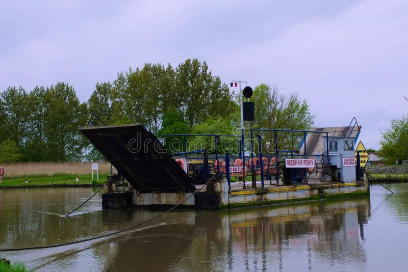 Ferry over the river Yare. Reedham chain ferry takes vehicles and pedestrians over the river Yare and is the only crossing point between Norwich and Great royalty free stock images