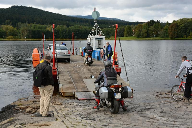 Small ferry at Lipno - dam at Sumava mountains. Ferry provides transportation between the villages of Horni Plana and Blizsi Lhota stock images