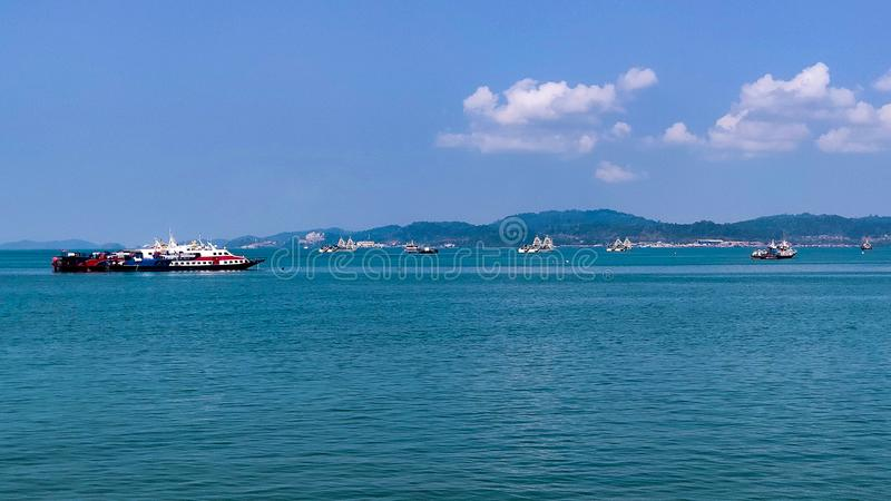 The ferry ship sailing at the sea taking the tourist around the Langkawi island royalty free stock photo