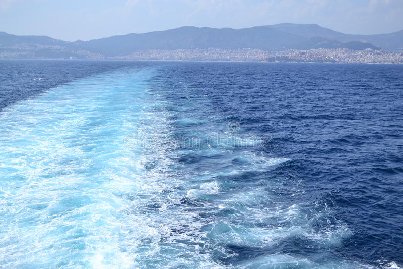 Ferry trail on water. On the way to Thassos royalty free stock photography