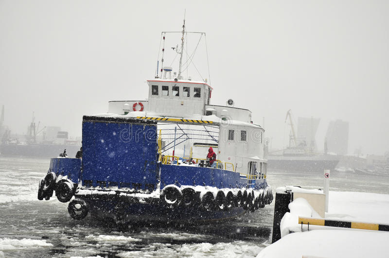 Ferryboat. Ferry is moored at the port in a storm stock photo