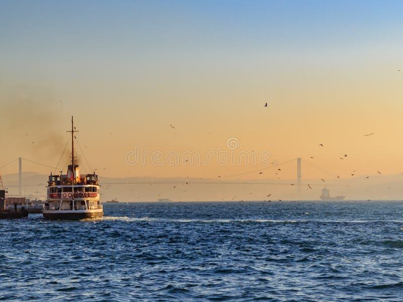Ferryboat in the bosphorous sea during sunrise royalty free stock image