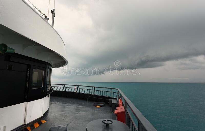 Ferryboat and Dramatic Storm Clouds. Cloud/seascape royalty free stock photo