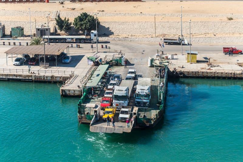 Ferryboat on the Suez Canal near Ismailia, Egypt. Ismailia, Egypt - November 5, 2017: Sarabum Ferryboat moored to the shore on the Suez Canal near Ismailia royalty free stock images