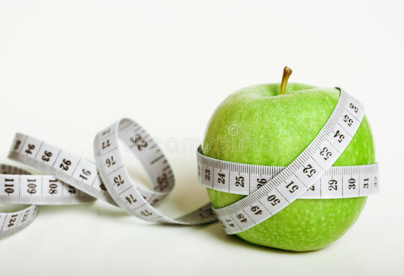 Download Fersh Green Apple With Measuring Tape Stock Photo - Image: 24487452