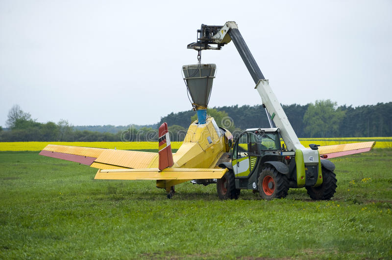 Fertilizing field by aircraft royalty free stock images
