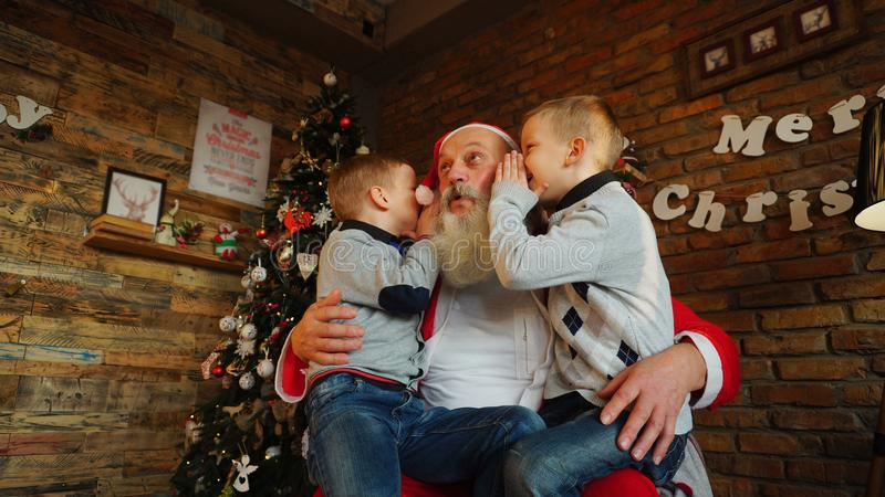 Three boys children keep New Years gifts in their hands and sha stock images