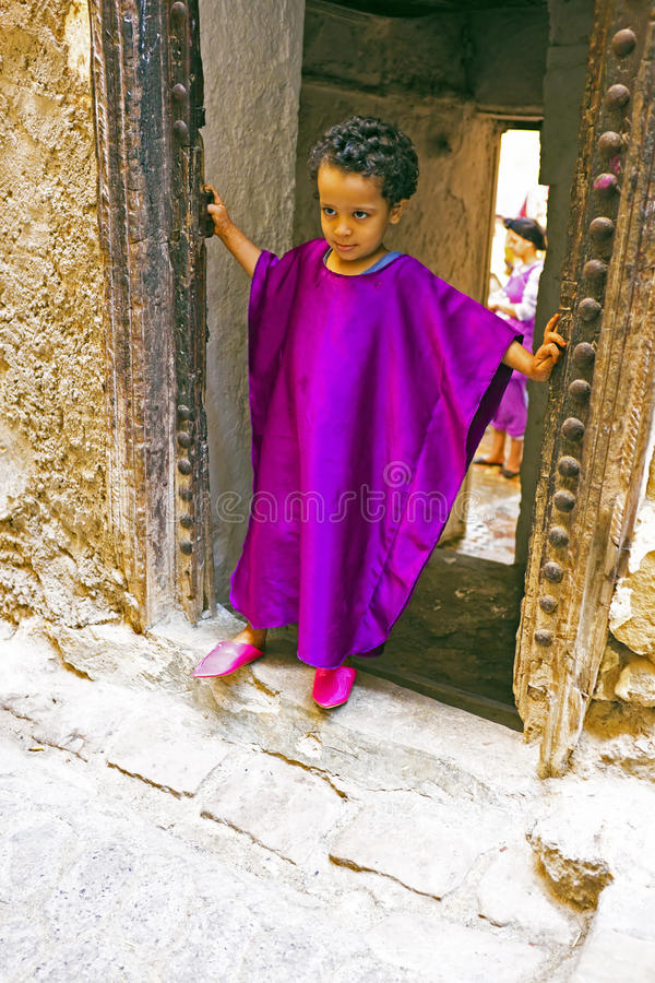 FES, MAROCCO - October 15 2013 : Kid beautifull dressed up on Eid al-Adha. The festival is celebrated by sacrificing a lamb or ot royalty free stock images