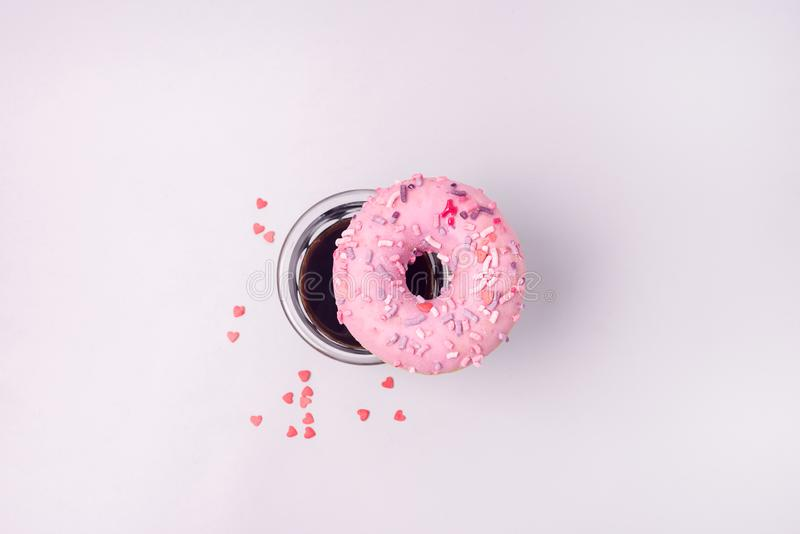 Fesh Pink Donut With Coffee Americano Flat Lay Top View Donut and Coffee stock photo
