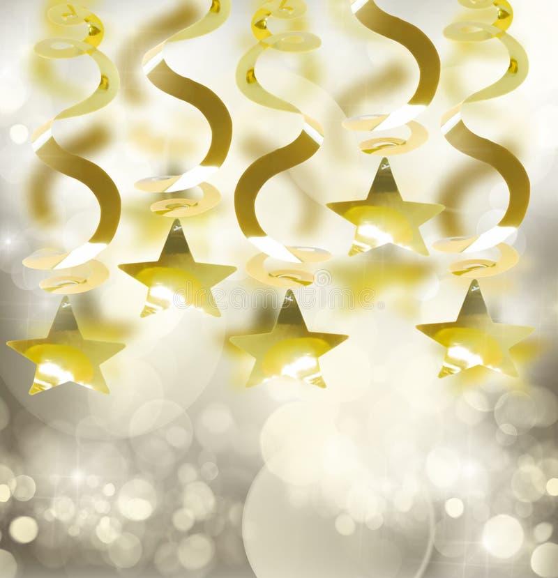 Festões douradas com estrela imagem de stock royalty free