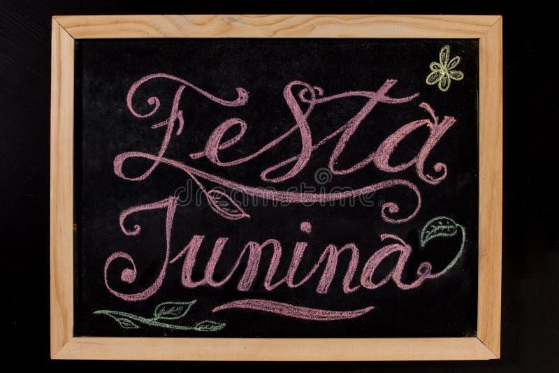 Festa Junina - mão colorida bandeira tirada da rotulação do giz fotos de stock royalty free