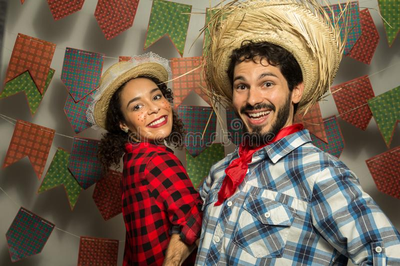Festa Junina: party in Brazil. Man and woman dressing checked pattern clothes. Man and woman dressing checked pattern clothes are royalty free stock photography