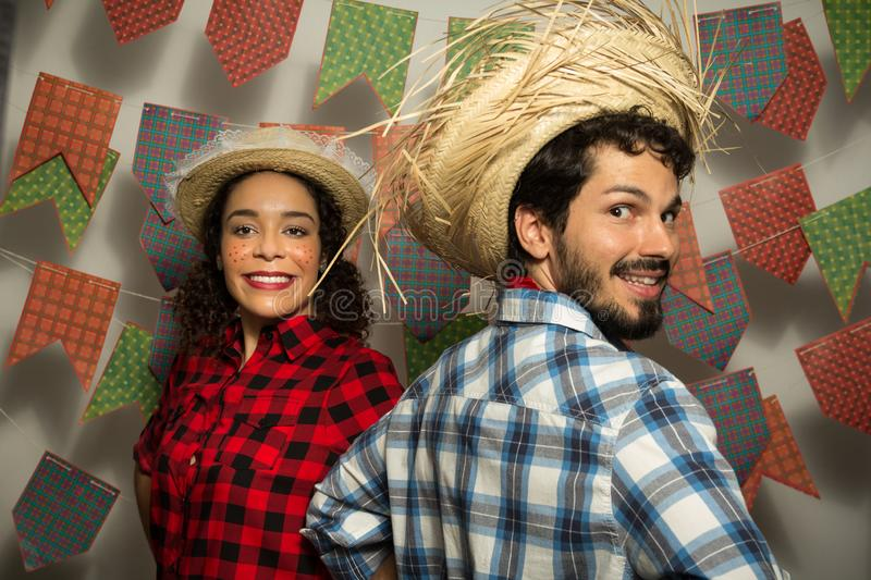Festa Junina: party in Brazil. Man and woman dressing checked pattern clothes. Man and woman dressing checked pattern clothes stock image