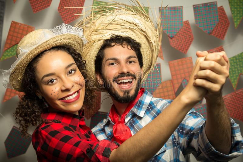Festa Junina: party in Brazil. Man and woman dressing checked pattern clothes. Man and woman dressing checked pattern clothes are royalty free stock photo