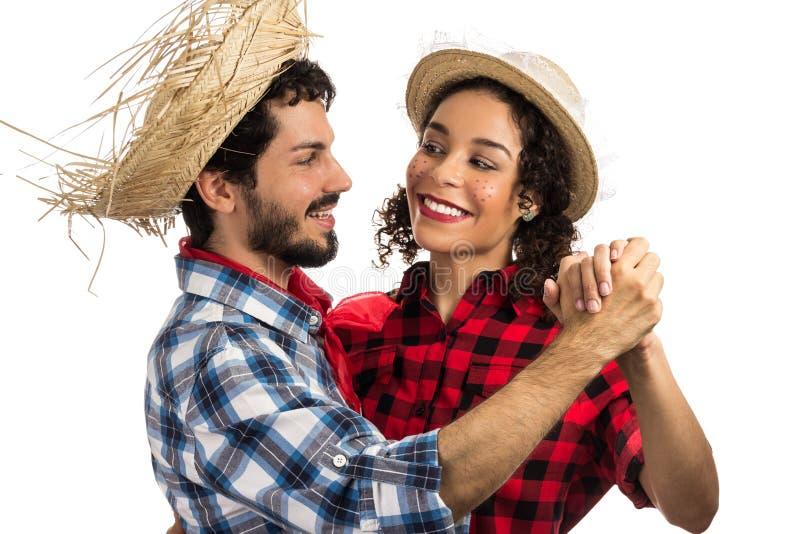 Festa Junina: party in Brazil. Brazilian couple wearing plaid sh stock photos