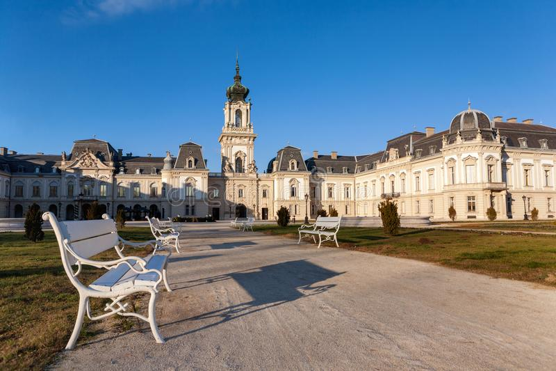 The Festetics baroque castle with white benches in the front near to Lake Balaton and Heviz in Hungary royalty free stock images