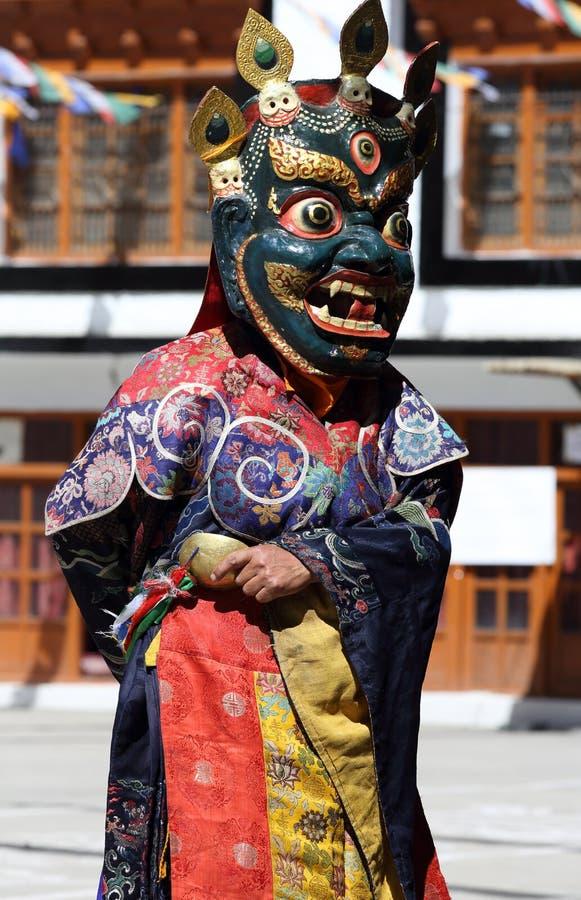Festival 2013, bailarín de Ladakh de la máscara con el vestido tradicional fotos de archivo