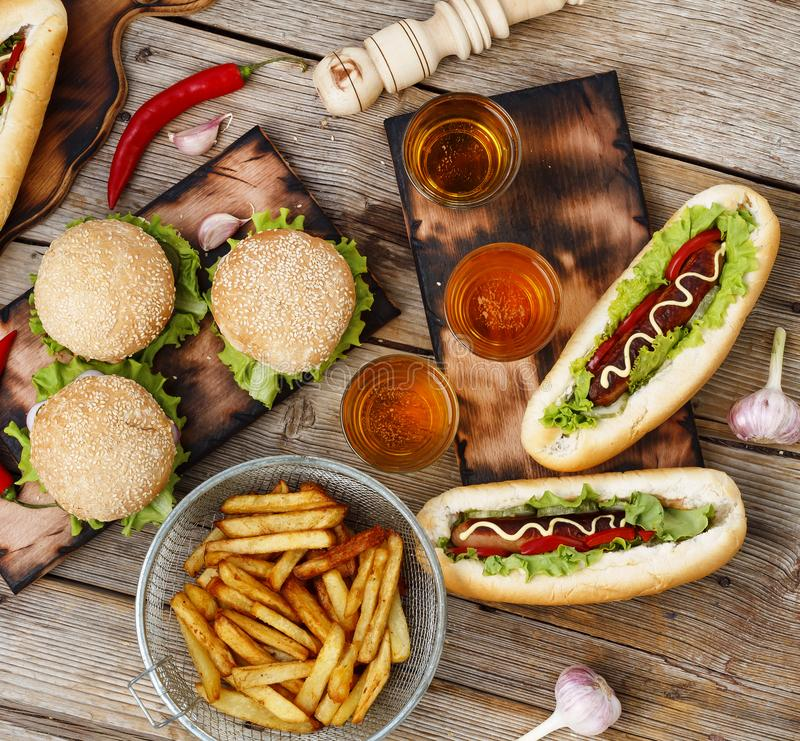 Festival of beer. Hot dogs, hamburgers, barbecue. Concept of eating outdoors. Concept of eating outdoors. Festival of beer. Hot dogs, hamburgers, barbecue stock photo