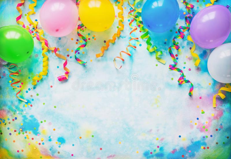Festival, carnival or birthday party frame with balloons, streamers and confetti. On colorful background with copy space stock photography