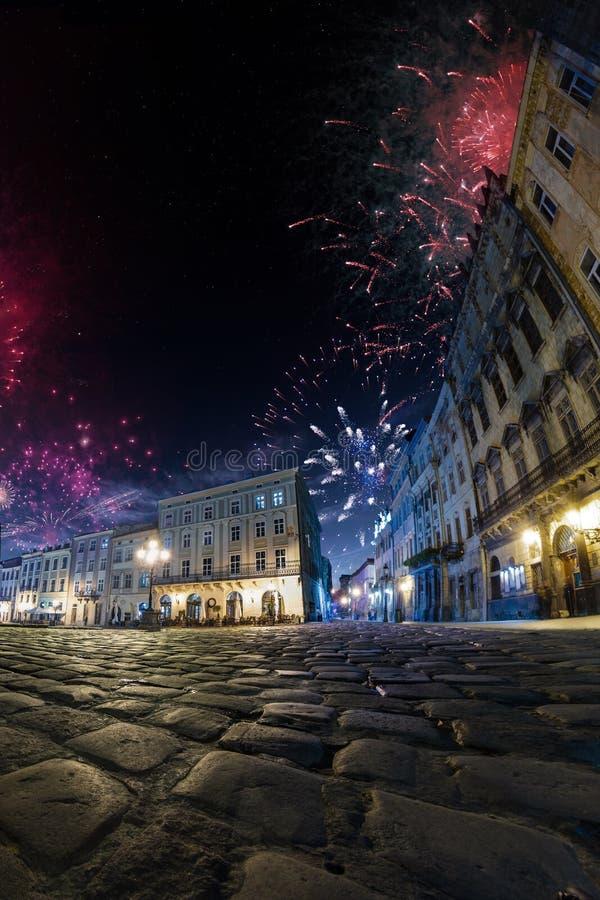 Festival celebration City background with Fireworks. Empty night plaza, old architecture. royalty free stock photo