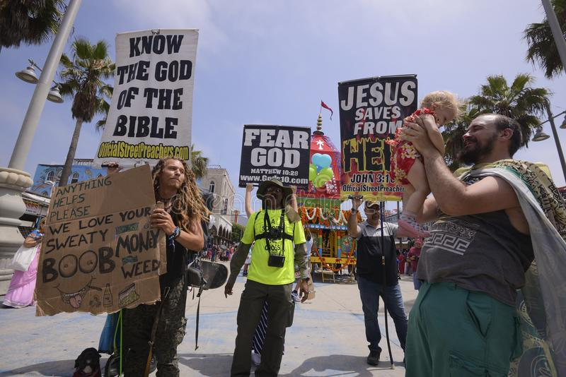 Festival of the Chariots. Protesters hold up signs during the Festival of the Chariots during the afternoon royalty free stock images