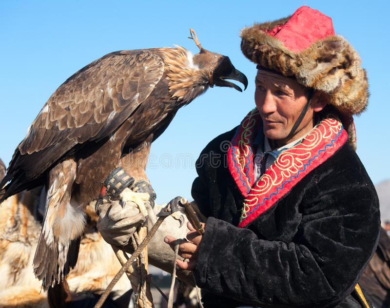 Festival of falconry. OLGIY, MONGOLIA - OCTOBER 2011; Festival of falconry in North West Mongolia. Kazakh national sport royalty free stock photos