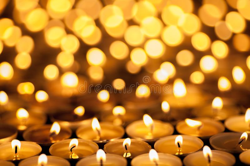 Diwali Festival of Lights. Beautiful candlelight. Selective focus on foreground of many burning tealight candles. Festival of Lights. Beautiful candlelight stock images