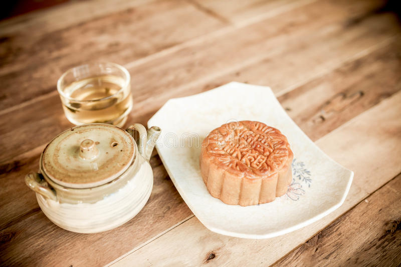 Festival moon cake and hot tea - Chinese cake stock image