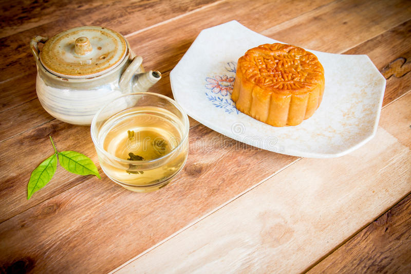 Festival moon cake and hot tea - Chinese cake stock photography