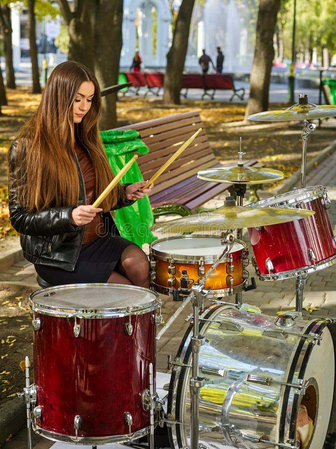 Festival music band. Friends playing on percussion instruments city park. royalty free stock photography