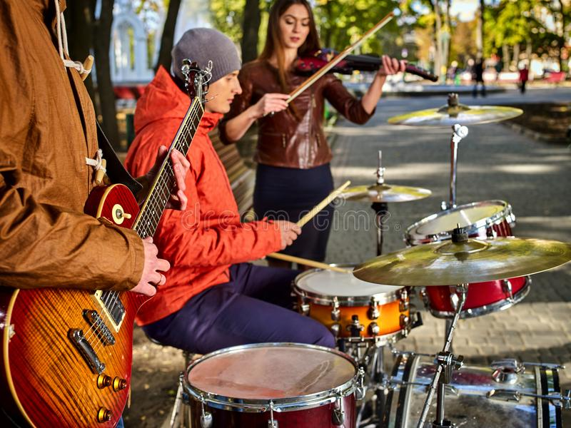 Festival music band. Friends playing on percussion instruments city park. stock photography