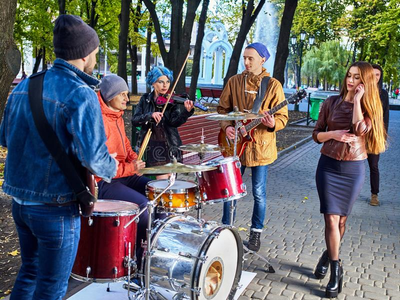Festival music band. Friends playing on percussion instruments city park. stock image