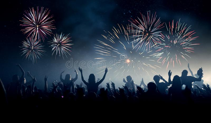 Festival or New Year background with crowd and fireworks stock photos