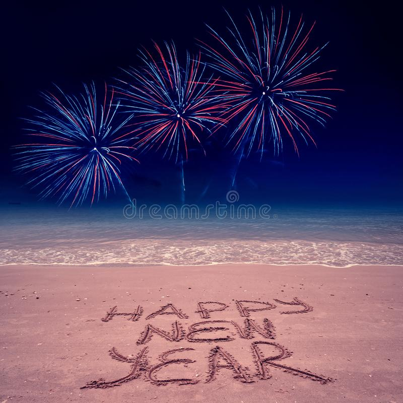 New Year beach background with fireworks stock photography