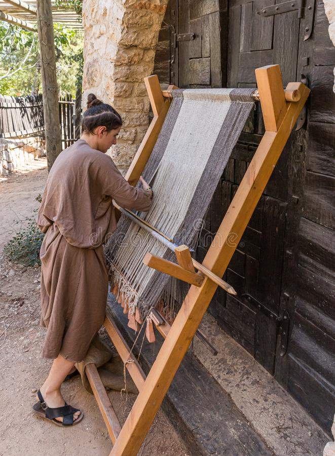 Festival participant demonstrates work on a medieval loom at the annual festival Jerusalem Knights. Jerusalem, Israel, September 30, 2019 : Festival participant stock photography