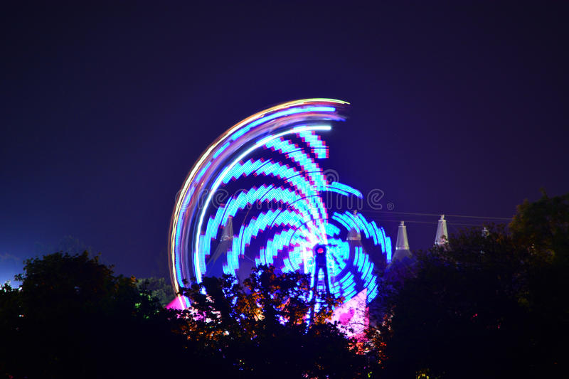 Download Festival Rides And Tree Silhouettes Stock Photo - Image: 93424893
