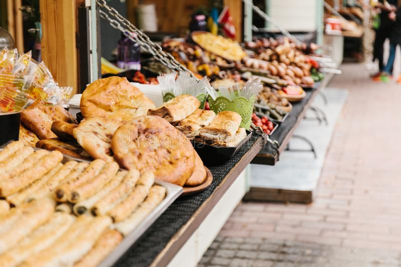 Festival shop, showcase of street food, pastry.  royalty free stock images