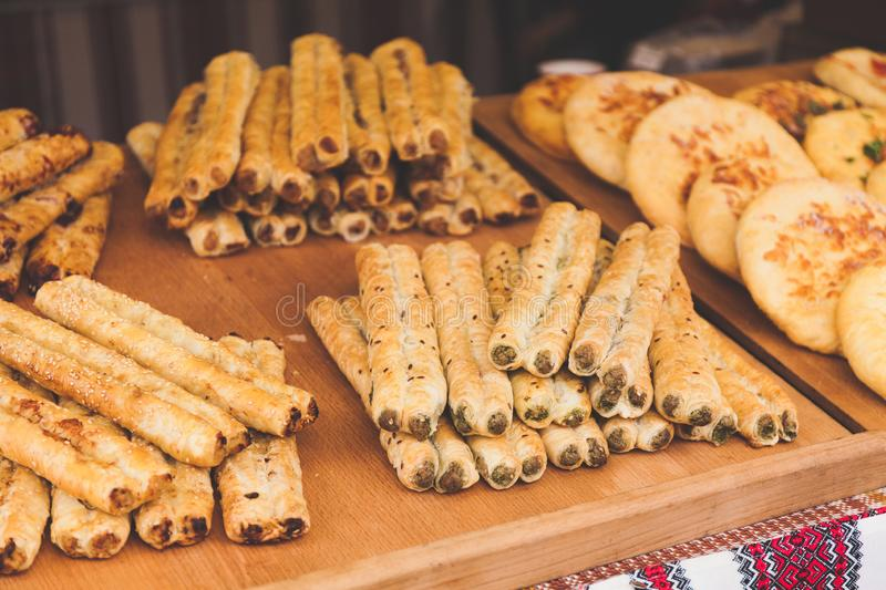 Festival of street food, fresh pastry on the show-window.  royalty free stock photos