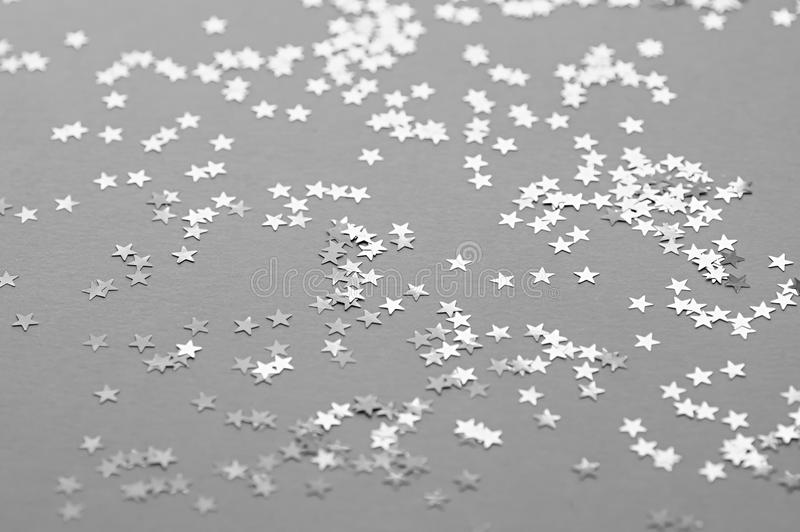 Festive abstract background. Silvery decorative stars. Selective focus royalty free stock image