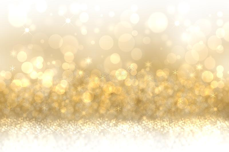 A festive abstract Happy New Year or Christmas texture background and with golden yellow blurred bokeh lights and stars. Space for stock images