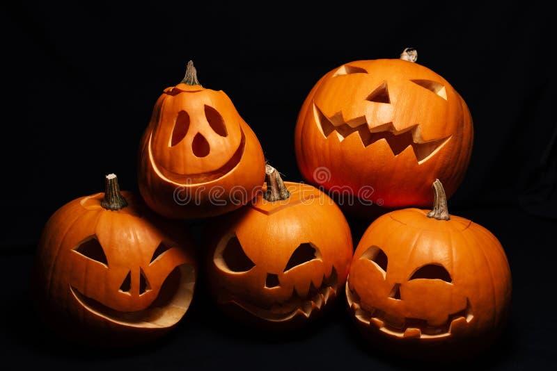 Festive autumn card with orange pumpkins. Jack`s lantern on Halloween celebration royalty free stock photo