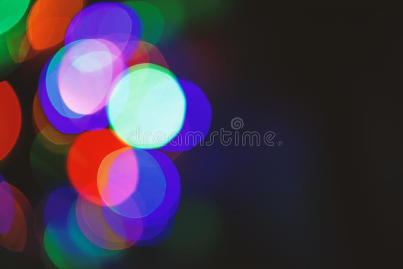 Festive backdrop with colorful lights. Bright and festive atmosphere of coming holiday. Abstract colorful bokeh stock image