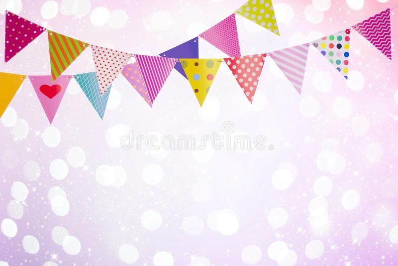 Festive background with colorful flags over abstract lights and glows stock images