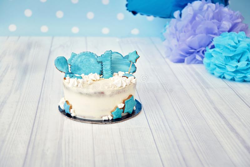 Festive background decoration for birthday with cake,blue balloons in studio, Boy Birthday Cake Smash first year concept. birthday. Greetings stock photo
