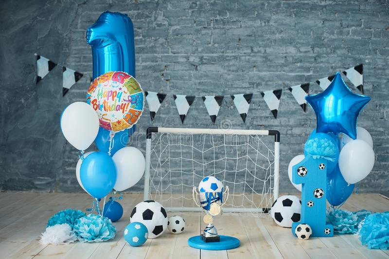 Festive background decoration for birthday with cake, letters saying one and blue balloons in studio, Boy Birthday .Cake Smash. Festive background decoration for stock photo