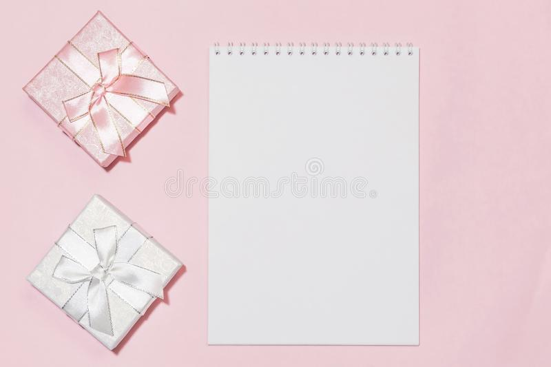 Festive background with gift wrapping with an assortment of boxes of pink, silver, color with a bow in pastel colors on a delicate royalty free stock image