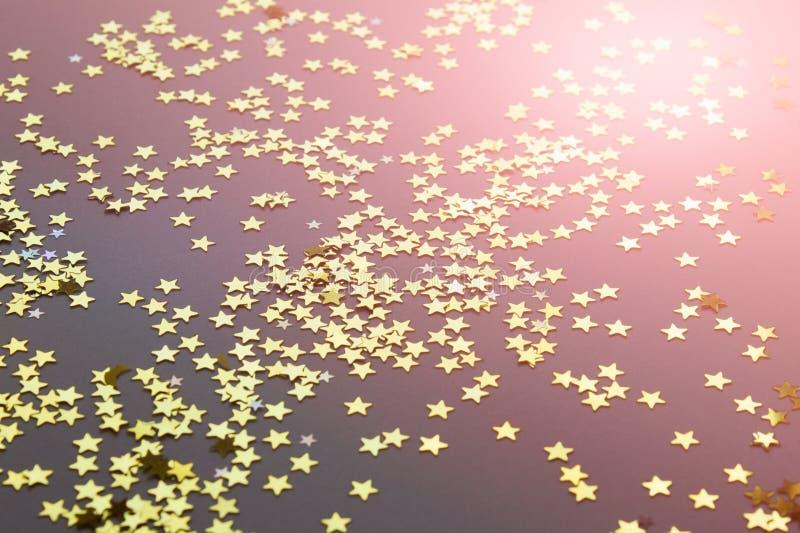 Festive background with shiny randomly arranged golden stars stock image
