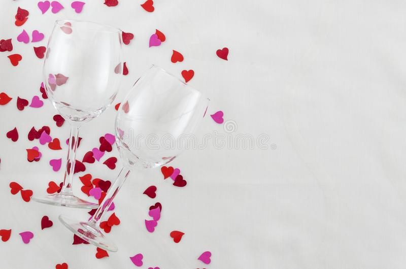 Festive background for Valentine`s day, couple of glasses, white background with hearts, top view stock photo